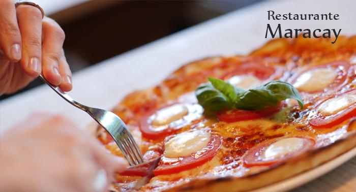 Disfruta de un menú para 2 personas: Ensalada + Pizza + Bebidas en Restaurante Maracay
